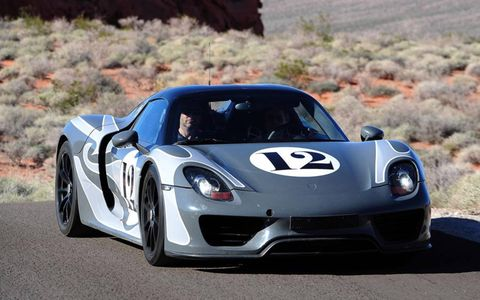 A Porsche 918 testing on desert roads.
