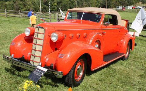 Art Deco in  Orange. Randy and Susan Denchfield's Series 50 Convertible Coupe is one of only 8,653 La Salles produced in 1935.