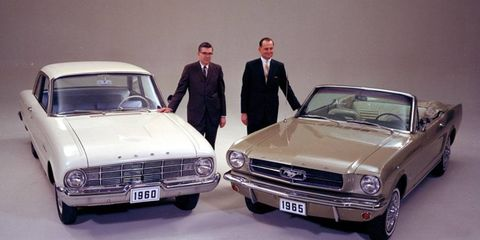 Donald Frey and Lee Iacocca are shown with key Ford products from the early 1960s--the 1960 Ford Falcon and the 1965 Ford Mustang.