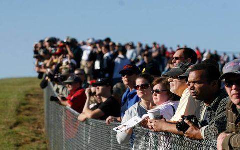 Spectators await the first cars at the Petit Le Mans endurance sports car race at Road Atlanta in Brasleton, Ga.