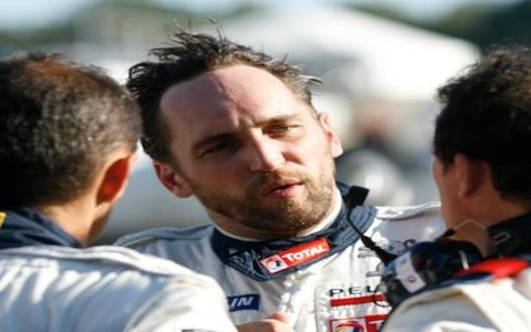 Peugeot driver Franck Montagny talks with team members after his warm-up laps around Road Atlanta during practice for the Petit Le Mans. Forty-four cars were entered in the 1,000-mile race that Montagny, along with teammates Pedro Lamy and Stephane Sarrazin, won in their LMP1 908 HDI FAP.