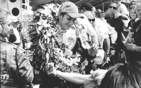 2005 Indy 500 winner Dan Wheldon celebrates.