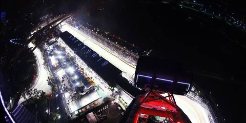 Bird's eye view // The Big Wheel Ferris wheel at Marina Bay Circuit provides a top-down look at the pit lane ahead of the Singapore Grand Prix.