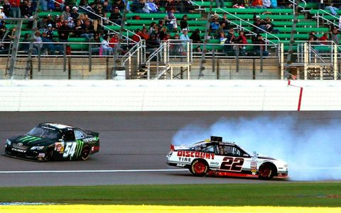 Kyle Busch blows by a spinning Brad Keselowski after giving Keselowski a not-so-friendly tap on Saturday during the NASCAR Nationwide Series race at Kansas.