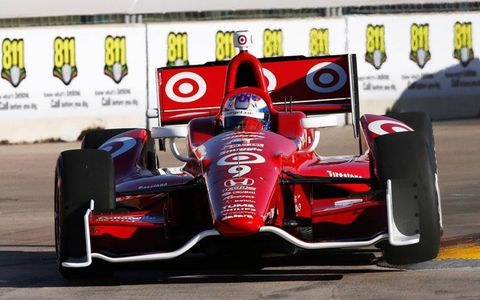 Scott Dixon pulled to within eight points of Izod IndyCar Series points leader Helio Castroneves with a win Saturday in Houston.