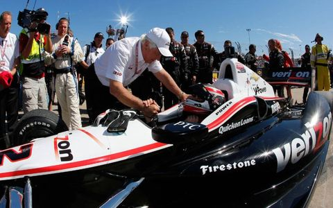 Will Power gets congratulated from the boss, Roger Penske, after Power's IndyCar win on Sunday in Houston.