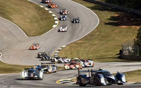 The Puegeot 908 leads the Audi R18 TDI and Peugeot 908 Hdi-FAP around Road Atlanta during Petit Le Mans on Oct. 1. Photo by: Drew Gibson/LAT Photographic