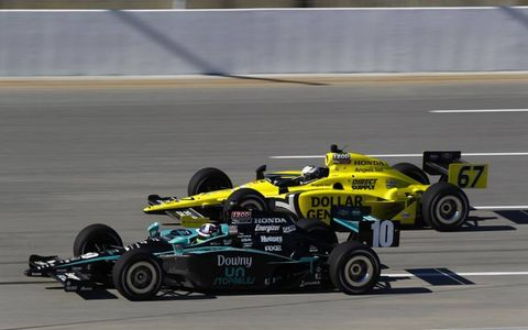 Ed Carpenter battles Dario Franchitti for the victory. Carpenter edges Franchitti out at the line to win his first IndyCar race. Photo by: Phillip Abbott/LAT Photographic