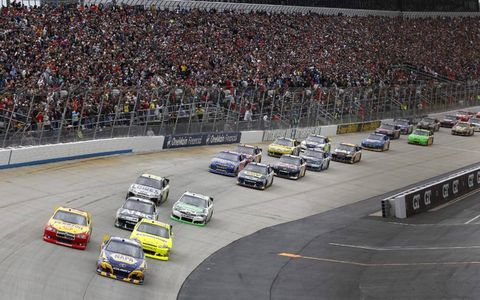 Martin Truex Jr. leads the field at the start of the NASCAR Sprint Cup race at Dover. Photo by: Dan Streck/LAT Photographic