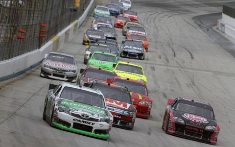 Kyle Busch leads a train of cars around the track. Photo by: LAT Photographic