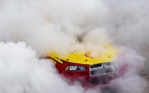 Smokin' Dueces // Kurt Busch celebrates his victory in the NASCAR Sprint Cup race at Dover International Speedway in Dover, Del., on Oct. 2 with some donuts. Photo by: Crystal A. MacLeod ASP Inc.