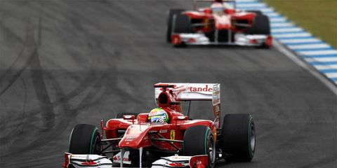An FIA report recommended Felipe Massa (front) be awarded first place at German Grand Prix.