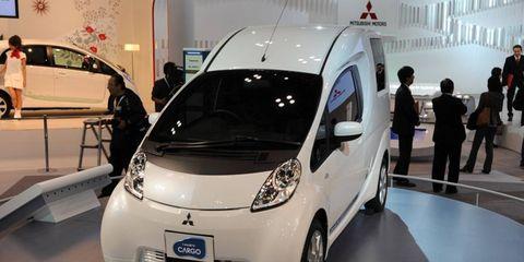 Motor vehicle, Automotive design, Land vehicle, Car, Auto show, Exhibition, Vehicle door, City car, Automotive mirror, Compact car,