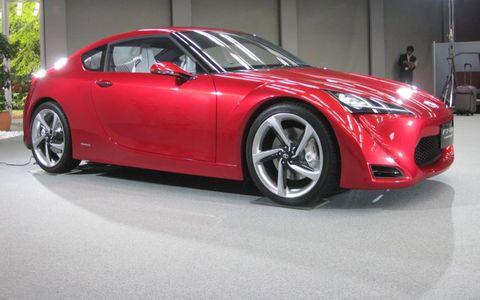 Tire, Wheel, Automotive design, Vehicle, Red, Automotive lighting, Car, Rim, Performance car, Alloy wheel,