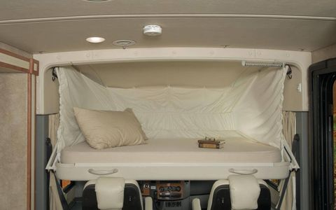 Optional on the Winnebago Via 25T and 25R, the StudioLoft bed drops from above the cab for more sleeping area.