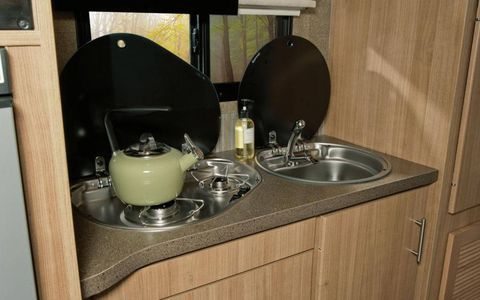 The galley of our Winnebago Via featured a sink with filtered water and dual-burner cooktop, plus a convection microwave oven.