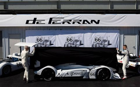 The Acura ALMS race car is unveiled in Chaparral livery. Jim Hall and Gil de Ferran do the honors.