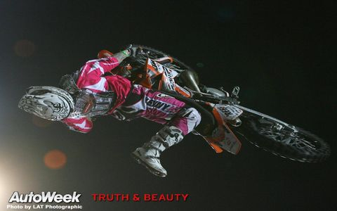 Darkness, Motocross, Toy, Fictional character, Graphics, Extreme sport, Graphic design, Motorcycle racer,