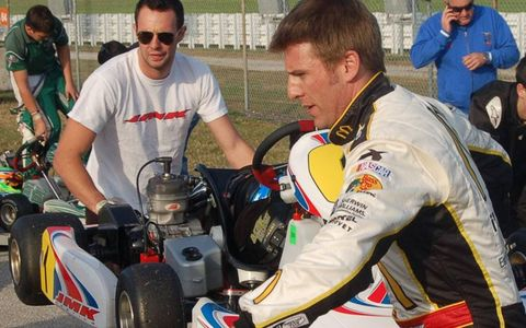 NASCAR driver Jamie McMurray, foreground, readies his kart.