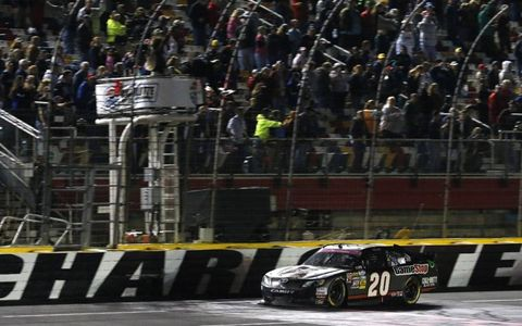 Joey Logano crosses the finish line at Charlotte.
