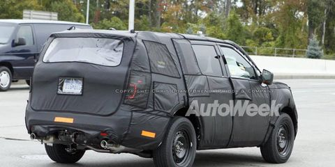 A light bar that crosses the rear hatch is a possibility, concealed under the cloaking on this 2011 Ford Explorer prototype.