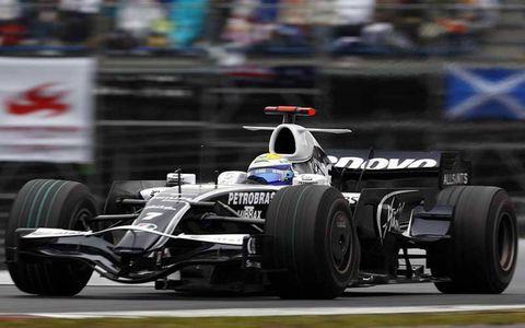 Jenson Button, Honda RA108, 14th position, leads Giancarlo Fisichella, Force India VJM01 Ferrari, retired, and Rubens Barrichello, Honda RA108, 13th position