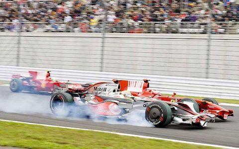 Lewis Hamilton, McLaren MP4-23 Mercedes, 12th position, leads Rubens Barrichello, Honda RA108, 13th position, and Sebastien Bourdais, Toro Rosso STR03 Ferrari, 10th position