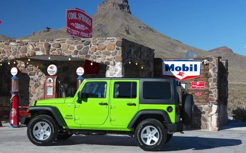 A profile of the Gekko Green 2013 Jeep Wrangler Sport Unlimited.