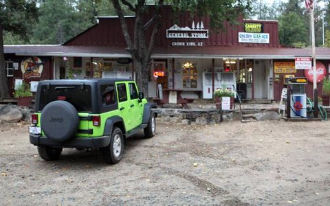 The 2013 Jeep Wrangler Sport Unlimited stopped at the General Store in Crown King, AZ.