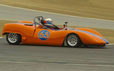 Alec Hugo in a 1964 Bobsy-Porsche SR-3 heads through turn 2 en route to winning the Gmund Cup.