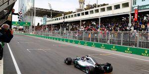 Lewis Hamilton takes the checkered flag in Baku.
