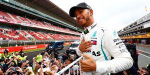Lewis Hamilton celebrates his latest Formula 1 triumph in Barcelona.