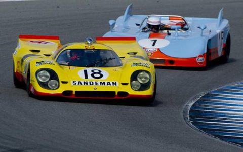 Gils Van Lennep (18) in a 1969 Porsche 917 leads Brian Redman (1) into turn 5 at Laguna Seca.
