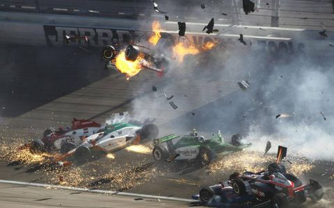 Cars get airborne in the crash that kills IndyCar driver Dan Wheldon.