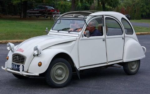 Lane Museum staffer James Green does a pre-rally test drive in a Citroën 2CV Voisin with one of participants.