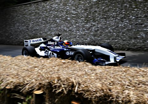 Former F1 driver Karun Chandhok takes the wheel of a Williams BMW FW26.