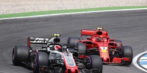 Kevin Magnussen, Haas F1 Team VF-18 Ferrari, leads Kimi Raikkonen, Ferrari SF71H during the 2018 German Grand Prix.