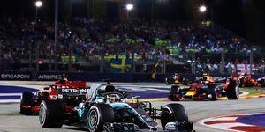 Lewis Hamilton leads the Formula 1 field in Singapore under the lights.