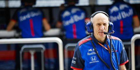 The team principal of Scuderia Toro Rosso says Formula 1 needs to reduce downforce levels by half to improve the racing product.