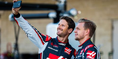 Romain Grosjean, right, and teammate Kevin Magnussen take selfies at Circuit of the Americas in Austin, Texas.