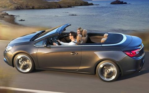The rear seats in the Opel Cascada convertible can fold to create more cargo room.