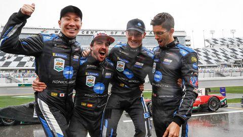 The winners celebrated at a wet Daytona International Speedway on Sunday.