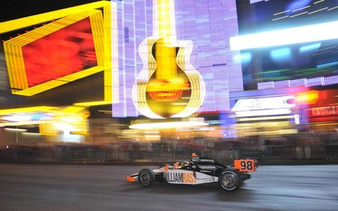 Dan Wheldon speeds down the Las Vegas strip during a parade of cars before the Izod IndyCar Series season finale at Las Vegas Motor Speedway. Wheldon died from injuries sustained in a multicar crash during the race. Photo by: Walt Kuhn/LAT Photographic