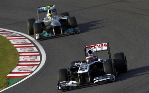 The Williams of Rubens Barrichello leads the Mercedes of Nico Rosberg in Japan. Photo by: Andrew Ferraro/LAT Photographic