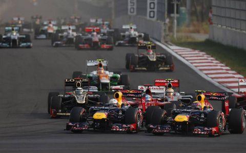 2012 Korean Grand Prix: Sebastian Vettel, Red Bull RB8 Renault, and Mark Webber, Red Bull RB8 Renault, lead the field away at the start.