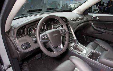 Motor vehicle, Steering part, Automotive design, Steering wheel, Automotive mirror, Center console, White, Technology, Speedometer, Vehicle audio,