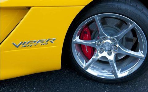 Tire, Wheel, Automotive tire, Automotive design, Alloy wheel, Automotive wheel system, Yellow, Automotive exterior, Rim, Spoke,