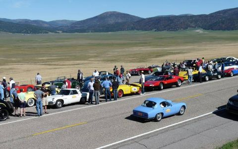 Wide shot of expanse of the caldera with Tour cars