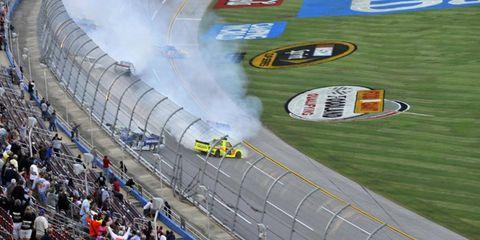 Johnny Sauter escapes a wreck to win in Talladega.