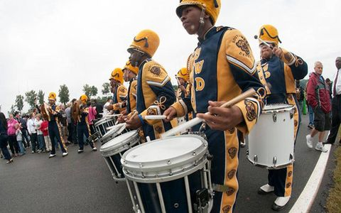 The Southwest Dekalb Marching Band makes its way down the starting grid prior to the start of the Petit Le Mans race at Road Atlanta on Saturday.